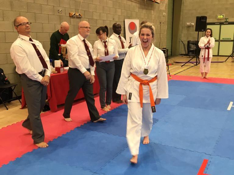 New karate student: Emily's first competition